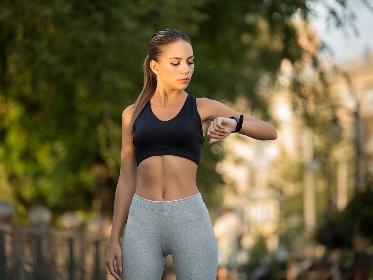Athlete checking movement tracker