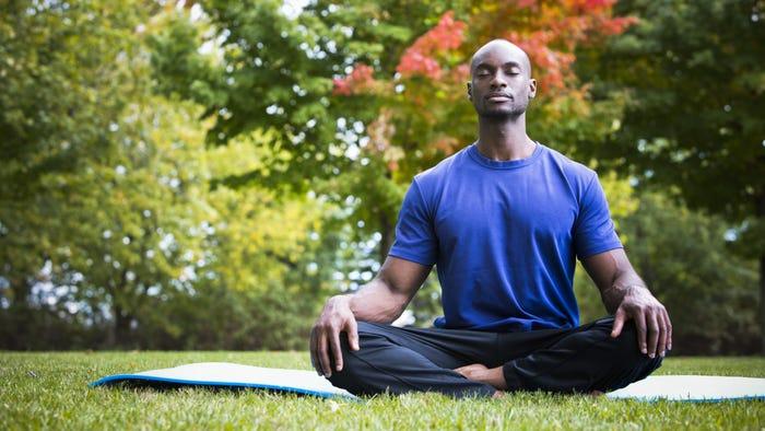 man meditating to improve sleep